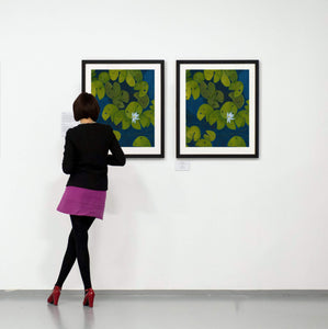 A deep blue & aqua blue pond with floating golden yellow lily pads and white flower blooms painting on a gallery wall with a patron viewer
