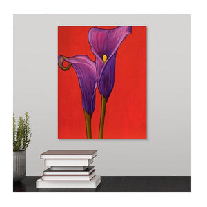 A painting by fine artist Nancy McLennon, by two deep purple calla lilies on red background hanging over a desk