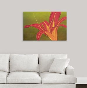A painting, by fine artist Nancy McLennon, of a single Ruby Spider day lily on green background hanging over a couch