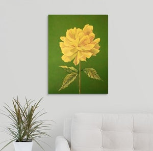 A painting, by fine artist Nancy McLennon, of a single a yellow rose on green background hanging over a couch