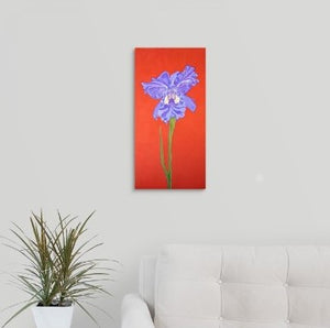 A painting, by fine artist Nancy McLennon, of a single Iris in full bloom on red background hanging over a couch
