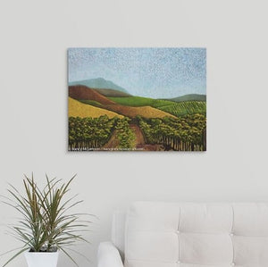 A painting of green and golden, sunlit vineyard hillsides of Napa Valley, California in the fall over a white couch