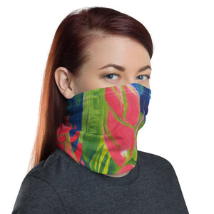 Woman wearing a knit fabric neck gaiter /face cover with a colorful floral painting, by fine artist Nancy McLennon, printed on the fabric