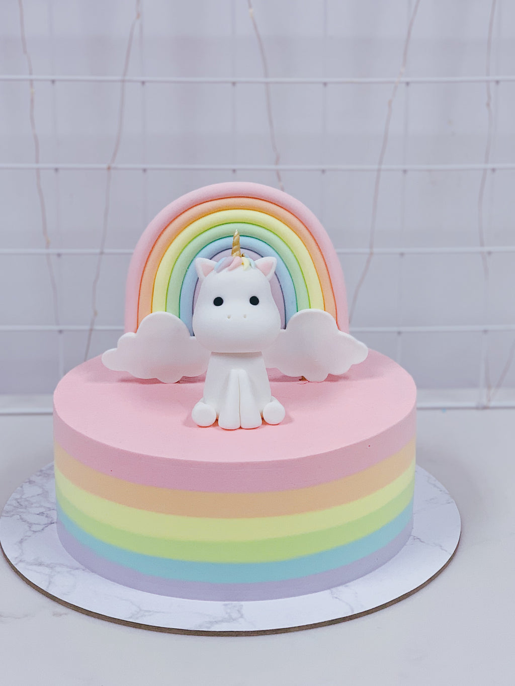 Pastel Rainbow Cake with Unicorn and Rainbow Topper