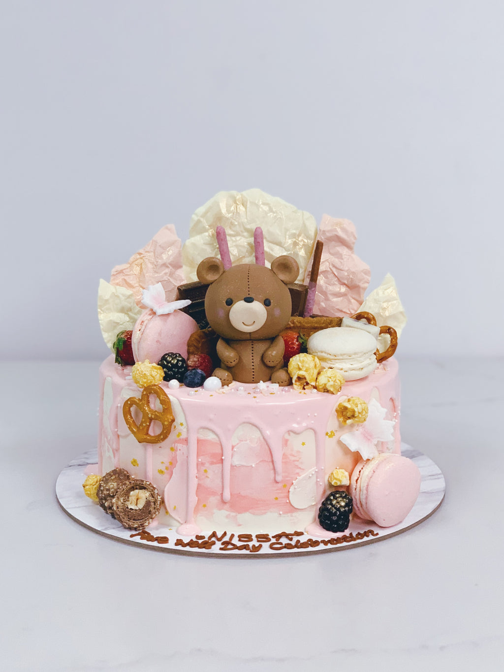 Bear Sweet Pink Drip Cake with Toppings and Chocolate Shards