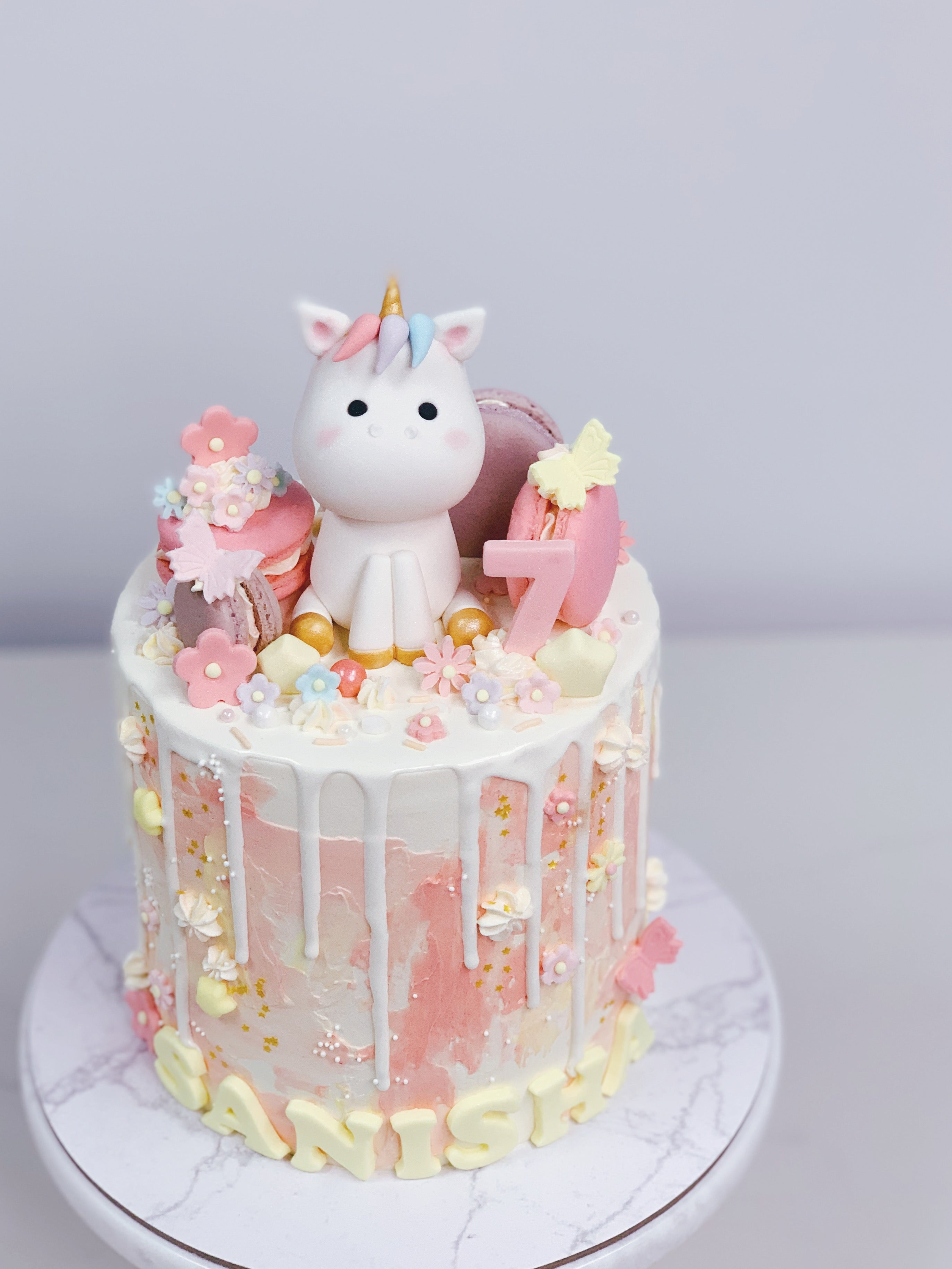 Pink Texture Chocolate Drip Cake with Unicorn and Macarons