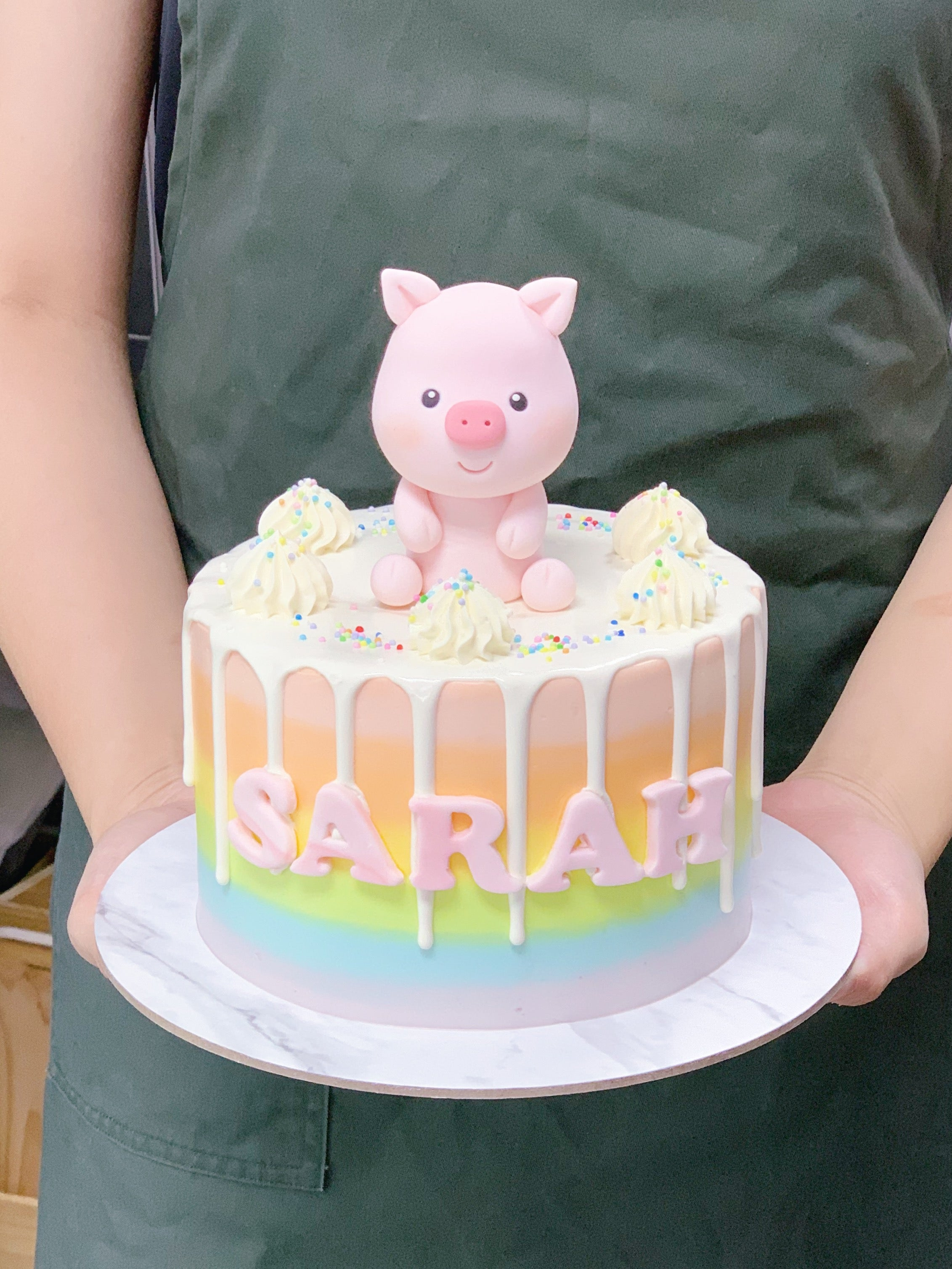 Pastel Rainbow Drip Cake with Pig Topper