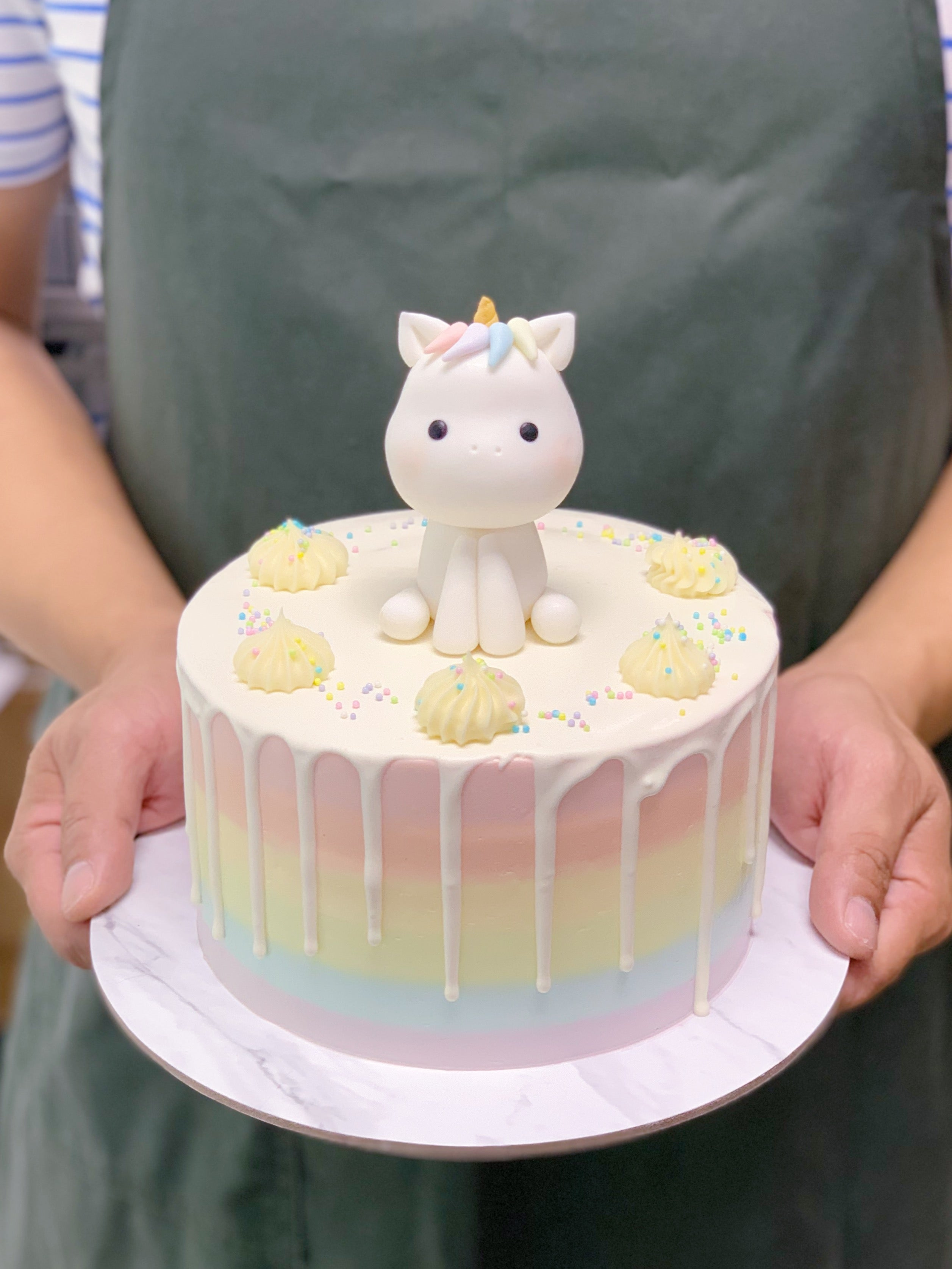 Pastel Rainbow Drip Cake with Unicorn Topper
