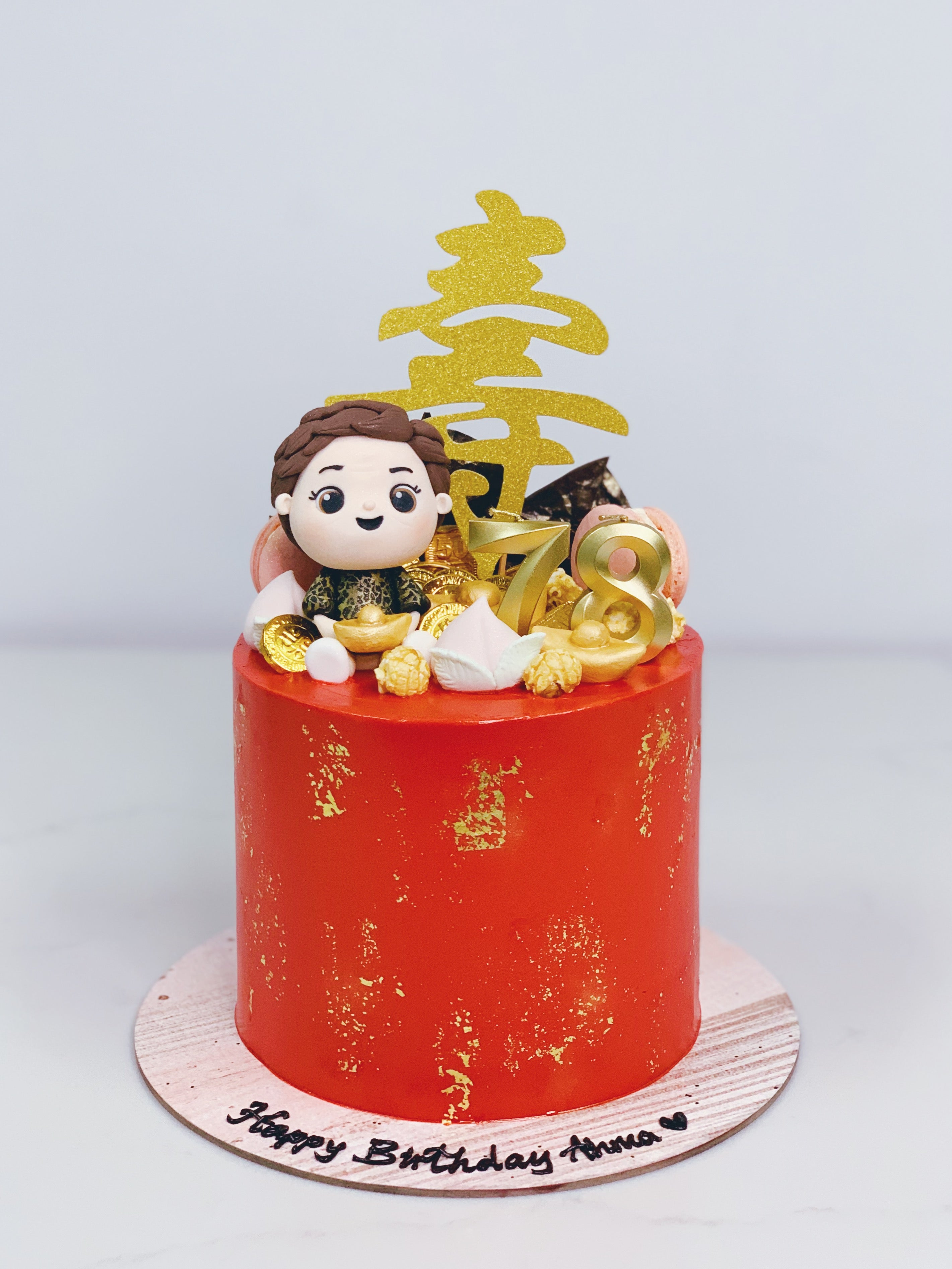 Red and Gold Longevity Cake with Figurine