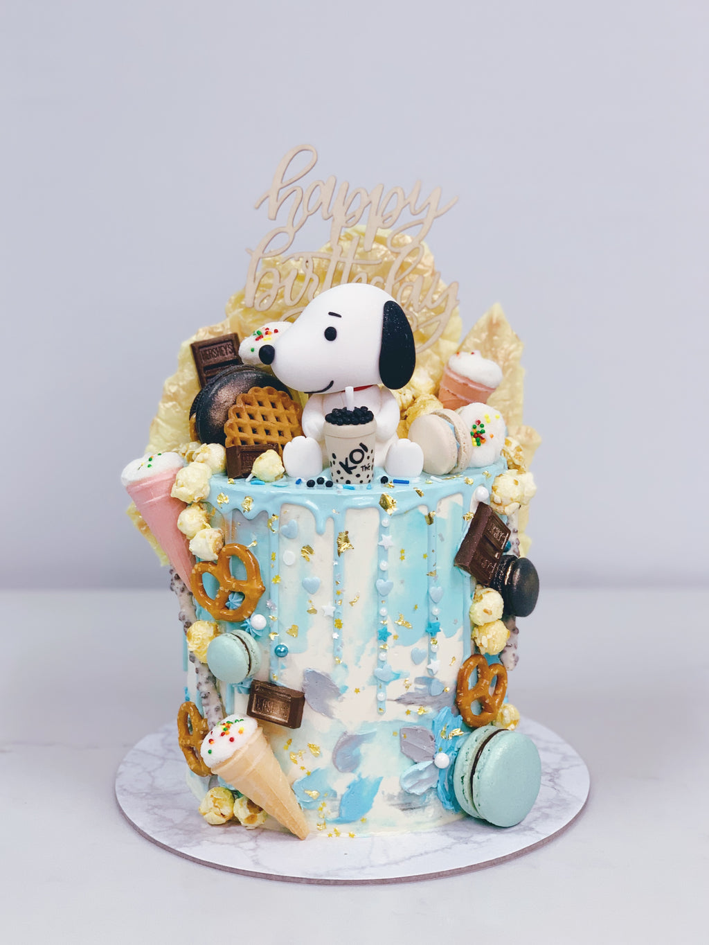 Snoopy Koi Blue Textured Drip Cake with Toppings and Chocolate Shards
