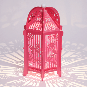 Fuchsia butterfly covered birdcage lanterns
