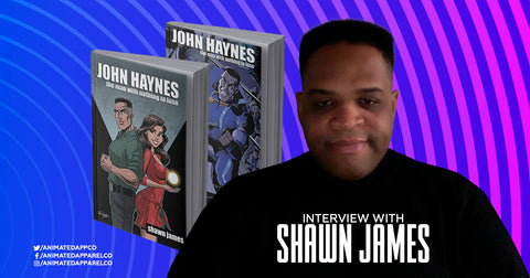 Image of Shawn James with his latest two books I Animated Apparel Company