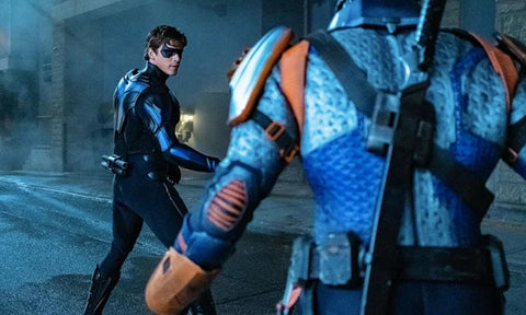 Nightwing reveals his new suit, and is fighting Deathstroke.