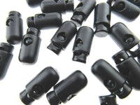 ** BLACK BARREL SPRING LOADED CORD LOCKS - CYLINDRICAL BULLET SHAPED TOGGLE