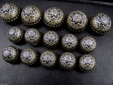 A Set of Antique Bronze Colour Metal Crested Dome Buttons