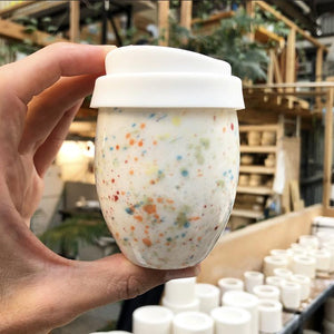 A white ceramic piccolo keep cup. The little cup resembles a timeless egg shape. The Good Egg keep cup is hand made in white Imperial porcelain and hand painted with a rainbow speckle