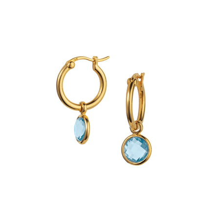 Product Shot of Gold and Blue Topaz Huggie Hoop Earrings