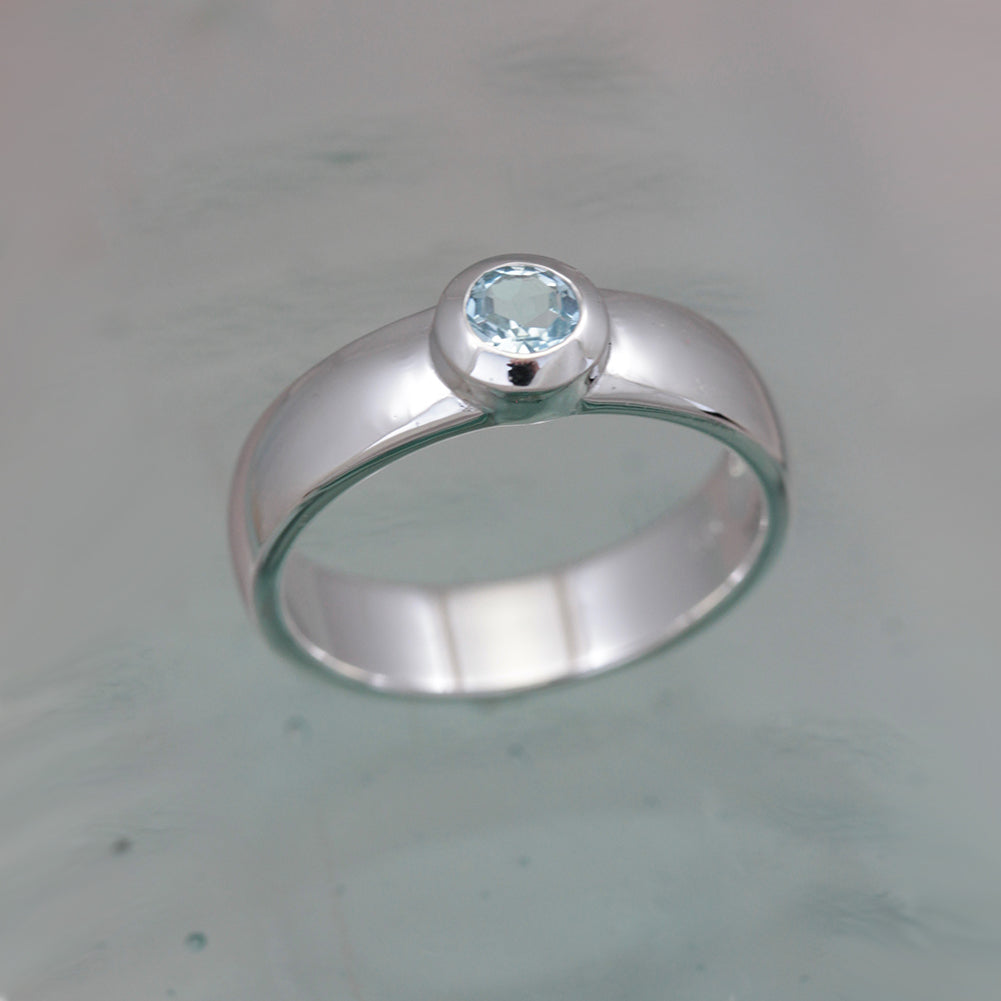 Silver and Blue Topaz Solitare Ring