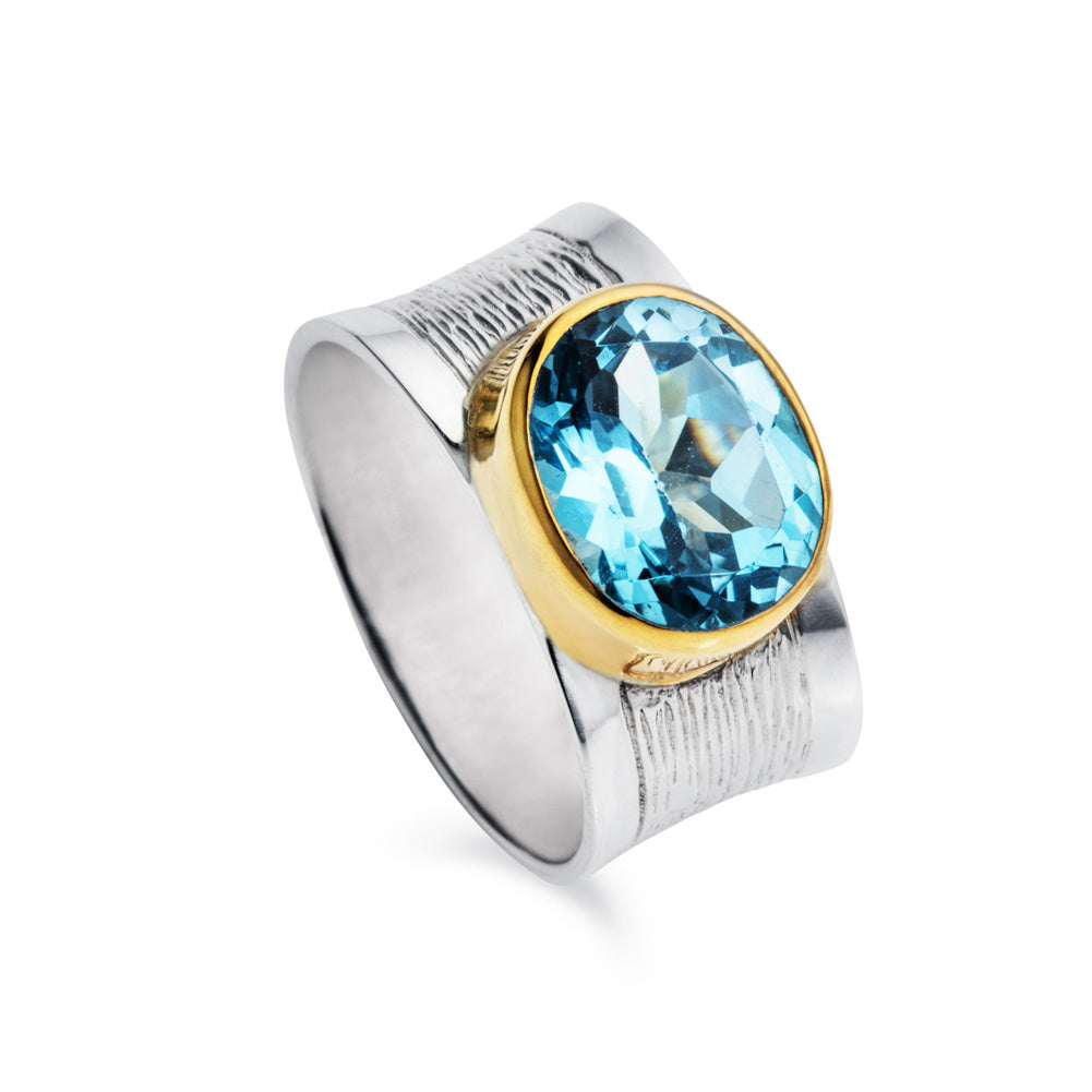 Wide Blue Topaz and Silver Ring with Gold Plated Bezel