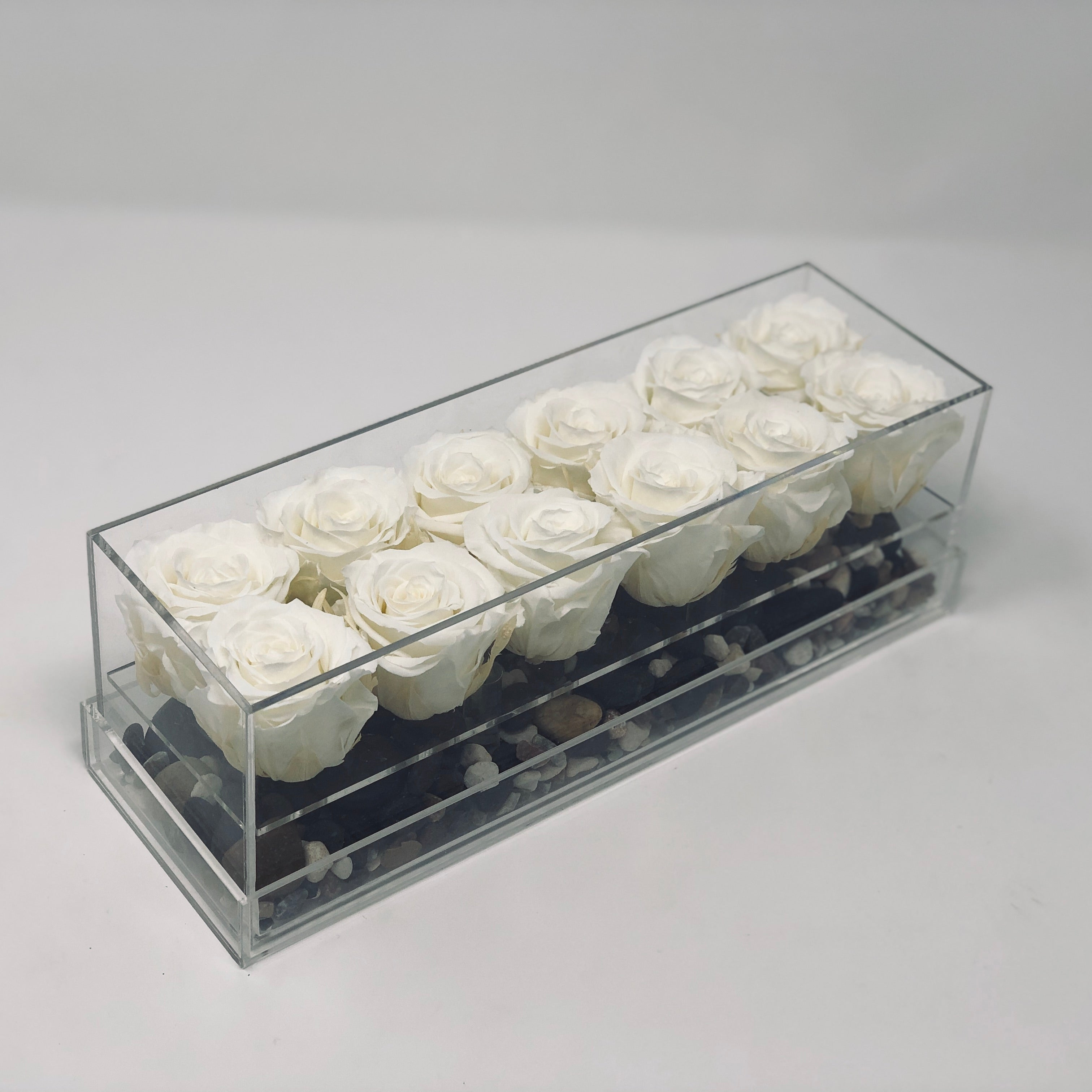 A dozen white forever roses that last for years in a modern acrylic rosebox