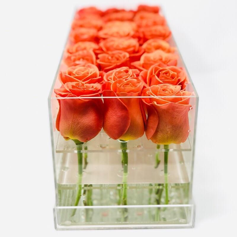 Modern rose box containing two dozen preserved long lasting roses of orange roses