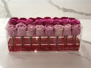 Modern rose box containing two dozen preserved long lasting roses in an ombre design of red roses, hot pink roses and pink roses