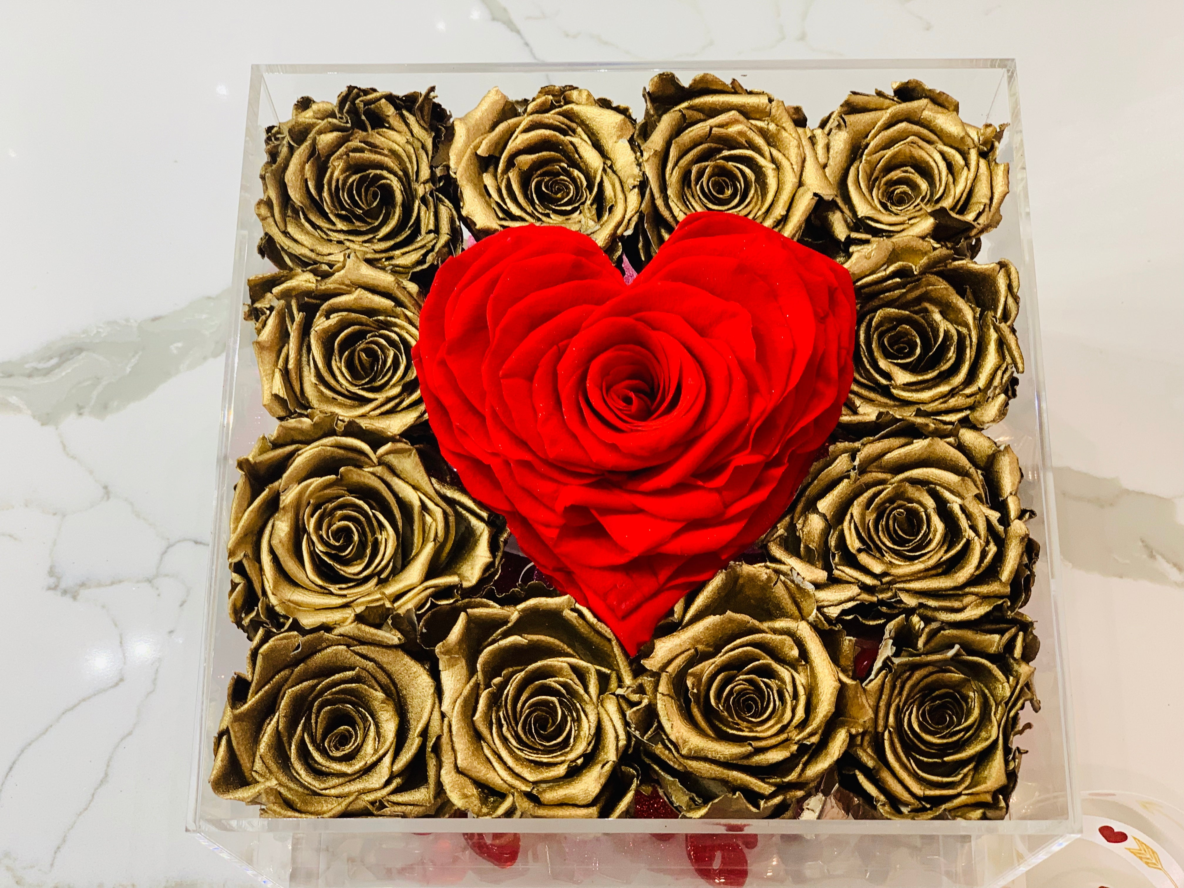 Modern Rose Box with preserved roses that last for years with metallic gold roses and accented with a red petal heart