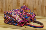 The Woman Time Caerli Woven Sheepskin Handbag In Multi Color