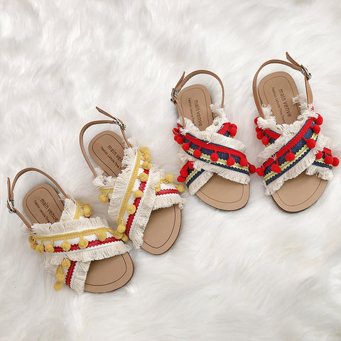 BOOPDO DESIGN CROSS OVER FLAT SANDALS WITH TASSEL AND POM POM DETAIL