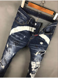 BOOPDO DESIGN ROCKETS DSQTWUX SPRAY PAINT RIPPED PATCH DENIM JEAN PANTS IN NAVY