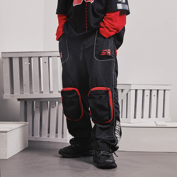 SHOW RICH DESIGNED BY ABOW LIFE MULTI POCKET TRACK PANTS IN BLACK - boopdo