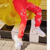 MAXIMARTIN MIXED PATTERN NEW YEAR RELAXED JOGGER PANTS IN RED - boopdo