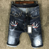 flying bird embroidery ripped lacquer denim jean short pants in blue
