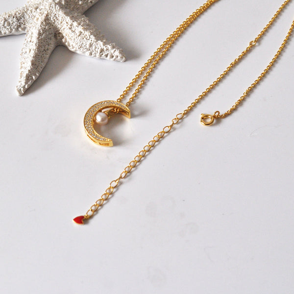 JELLY GIRL STERLING SILVER LONG NECKLACE WITH PEARL AND CRYSTAL MOON PENDANT IN GOLD