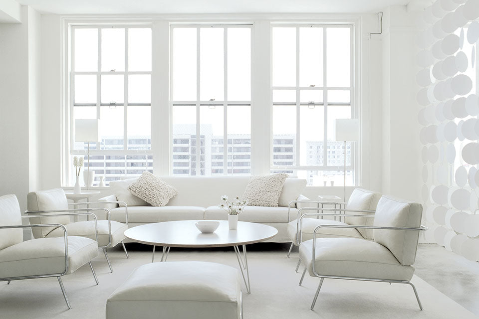 On-trend modern living room design featuring all white decor