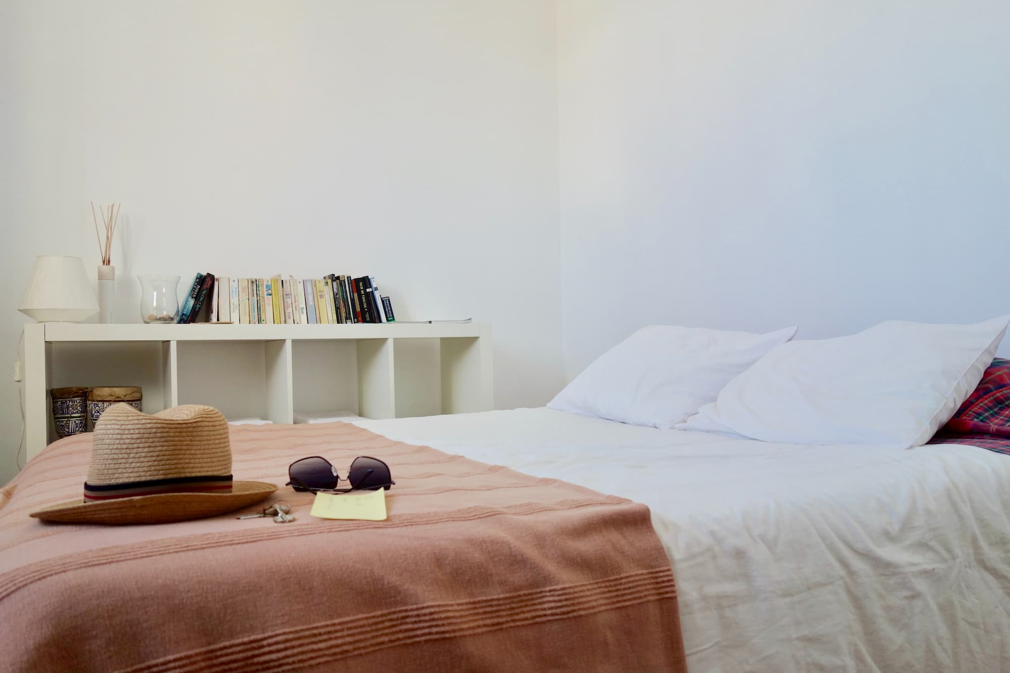 Closeup of simple, cozy bedroom representing shared economy lodging