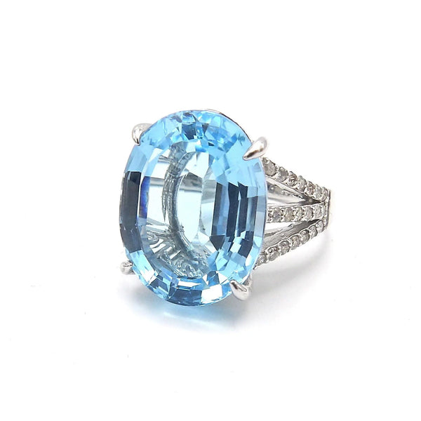 14K White Gold, Diamond, and Blue Topaz Ring 19+. Carats Ring Kirsten's Corner Jewelry
