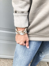 The gold and tan bangles set