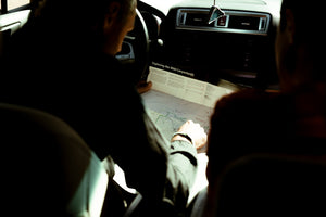Logan checking the map in his car