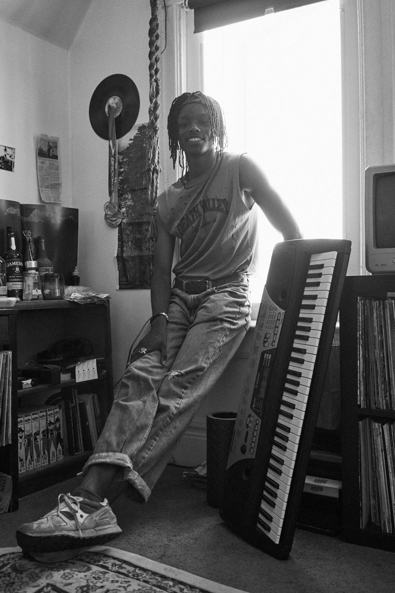 Ellis Newton at home with music gear