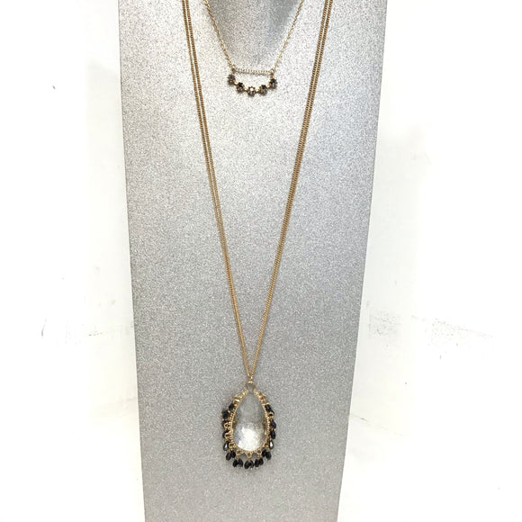Gold colored double necklace with black stones and crystal tear drop designs