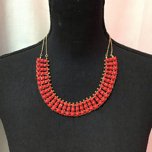Sarina gold color necklace with red stone design