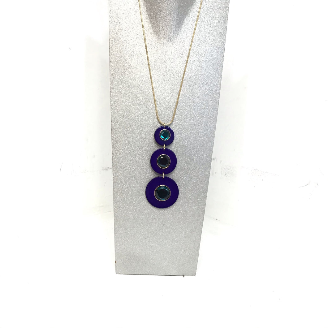 Sarina gold color necklace with blue and aqua circle design