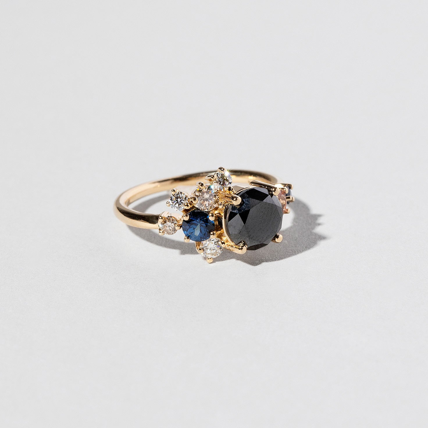 Vega Stone Cluster Ring with black diamond center stone