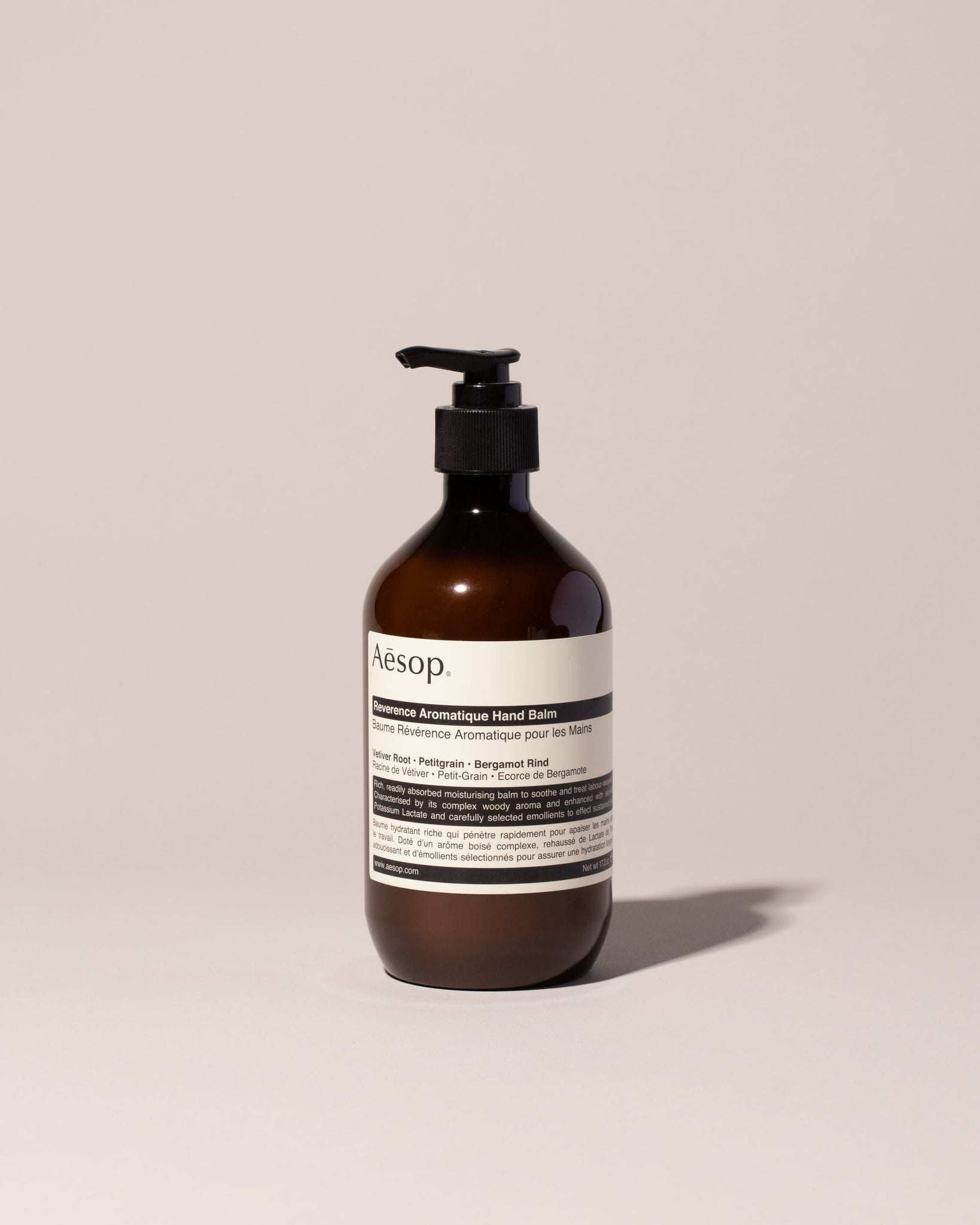 Aesop Reverence Hand Balm front view, dark brown pump bottle with a white label