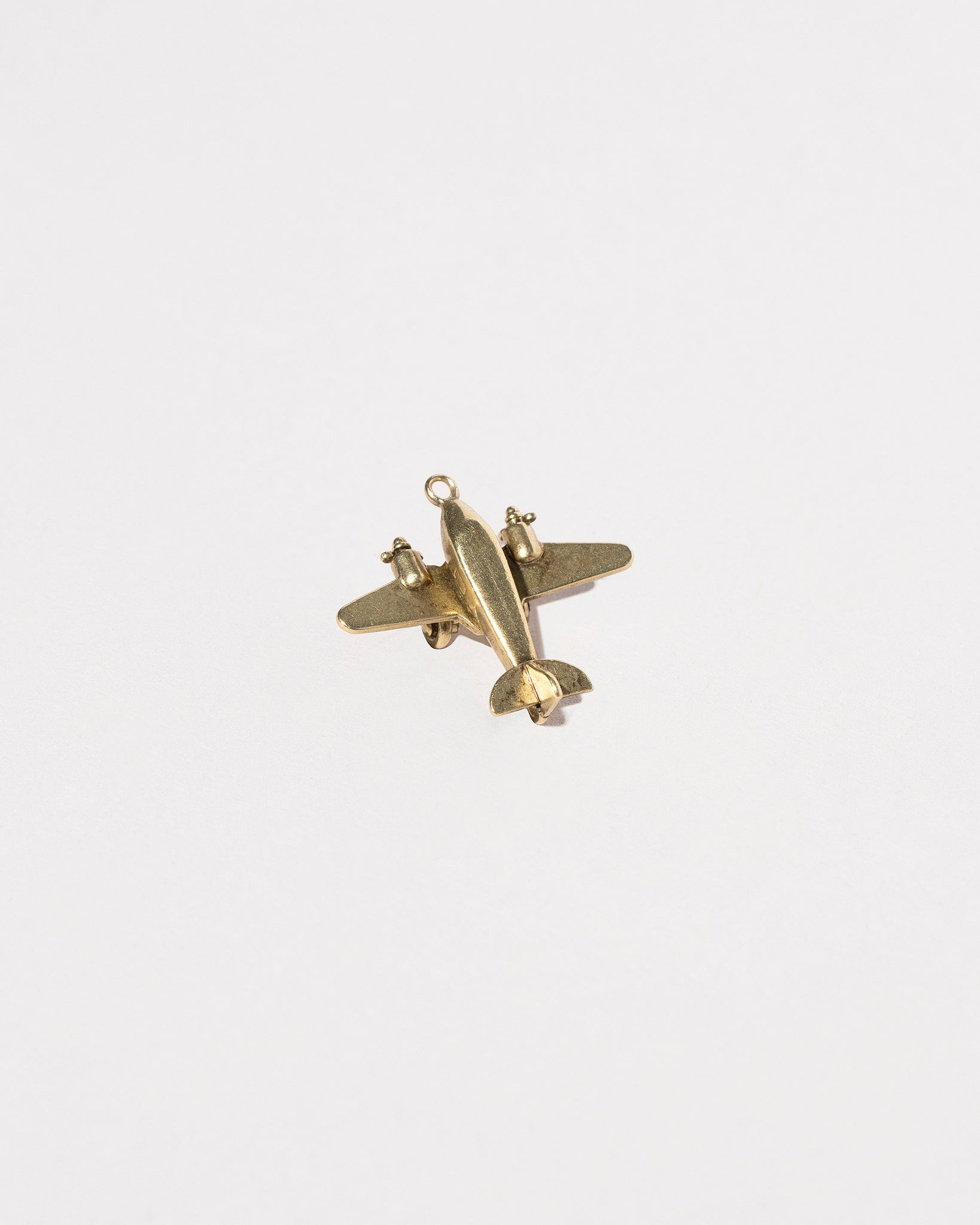 Airplane Charm on light color background