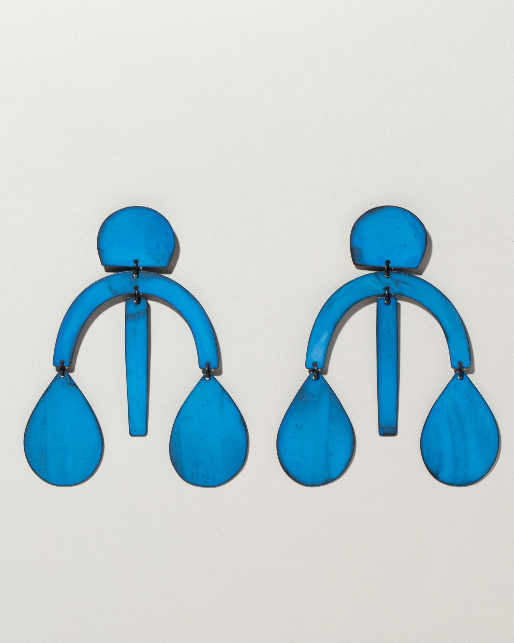 Arc Drop Chandelier Earrings in blue oxide