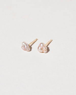 Bubble Pearl Stud Earrings on light color background