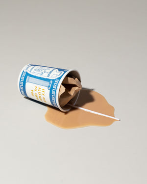 Fake spill of coffee cup with straw and crumpled paper
