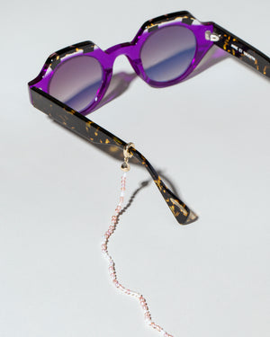 Pink and White Convertible Optical Necklace on sunglasses